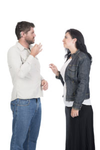 Man and woman communicate using ASL